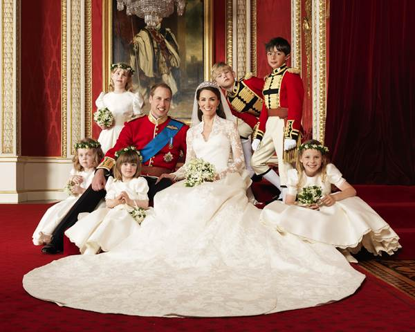 In this photo provided by Clarence House on Saturday, April 30, 2011, Britain's Prince William, center left, and his wife Kate, Duchess of Cambridge, center right, pose for a photograph with, clockwise from bottom right, Margarita Armstrong-Jones, Eliza Lopes, Grace van Cutsem, Lady Louise Windsor, Tom Pettifer, and William Lowther-Pinkerton in the Throne Room at Buckingham Palace, following their wedding at Westminster Abbey, London, on Friday, April 29, 2011. (AP Photo/Hugo Burnand, Clarence House) EDITORIAL USE ONLY